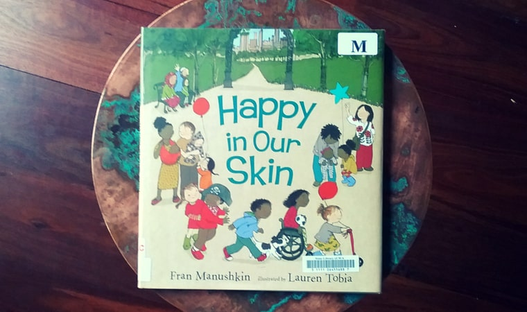 cover of Happy in Our Skin by Fran Manushkin
