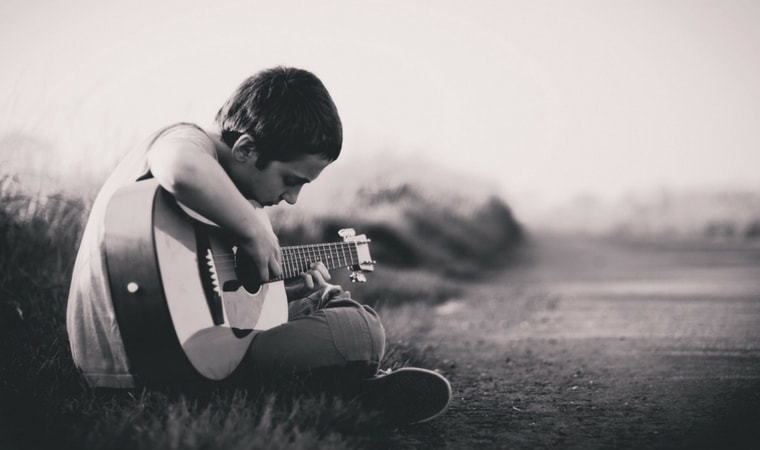 boys with signs of puberty in boys playing guitar